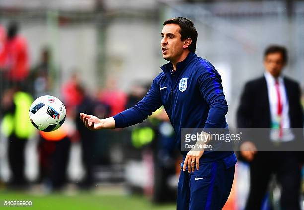 Gary Neville coach of England picks up the ball during the UEFA EURO 2016 Group B match between England and Wales at Stade BollaertDelelis on June 16...