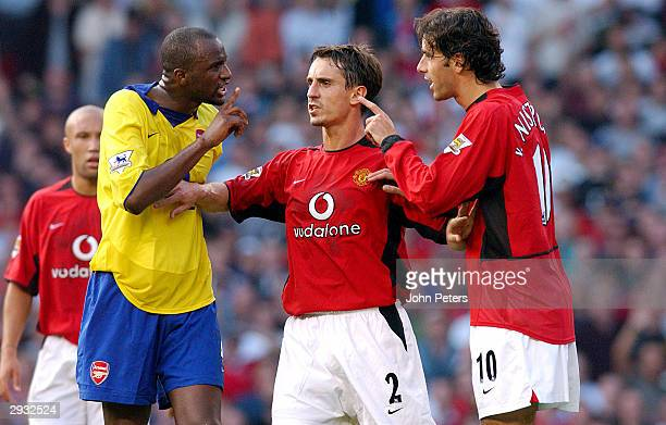 Gary Neville holds Patrick Vieira and Ruud van Nistelrooy apart prior to Vieira being sent off during the FA Barclaycard Premiership match between...