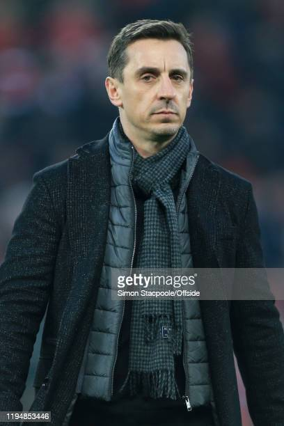 Gary Neville looks on during the Premier League match between Liverpool FC and Manchester United at Anfield on January 19 2020 in Liverpool United...