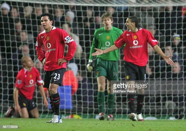 Gary Neville, Louis Saha, Wes Brown, Kieran Richardson, Edwin van der Sar and Rio Ferdinand of Manchester United react to David Bentley scoring their...