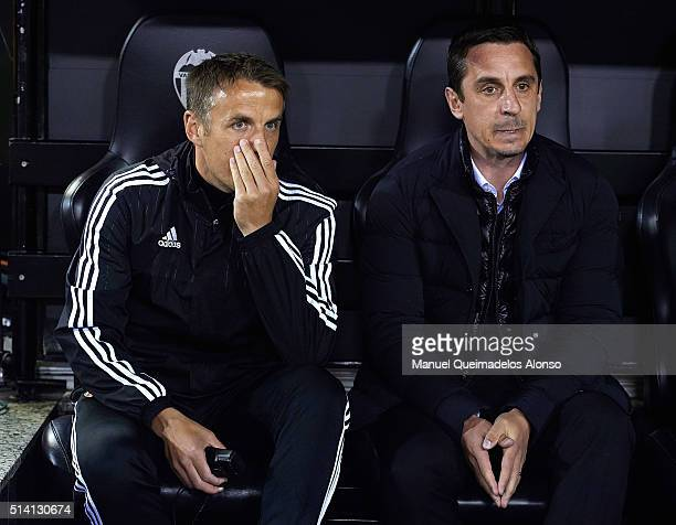 Gary Neville manager of Valencia and Phil Neville assistant manager of Valencia talk prior to the La Liga match between Valencia CF and Atletico de...
