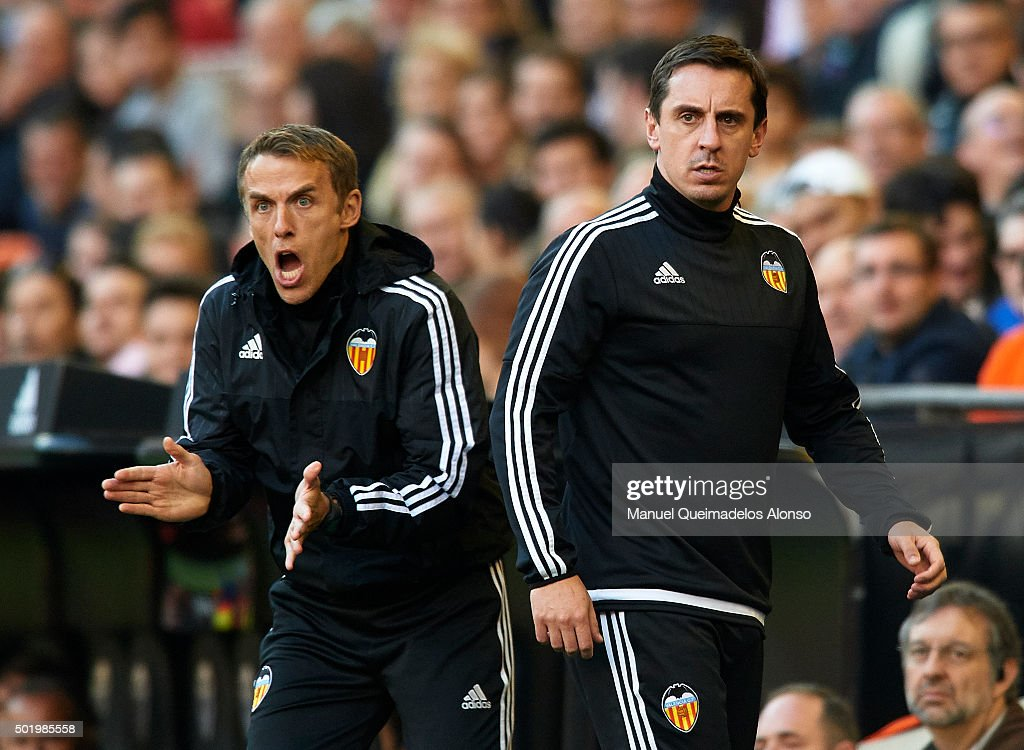 Gary Neville (R) manager of Valencia and Valencia assistant manager Phil Neville react during the La Liga match between Valencia CF and Getafe CF at Estadi de Mestalla on December 19, 2015 in Valencia, Spain.