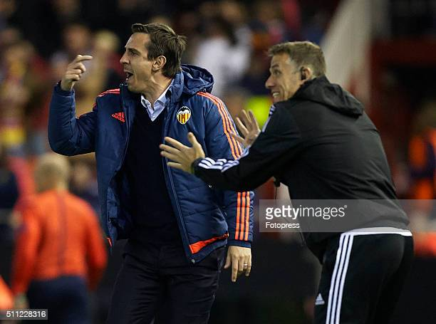 Gary Neville manager of Valencia CF and his assistant Phil Neville react during the UEFA Europa League round of 32 first leg match between Valencia...