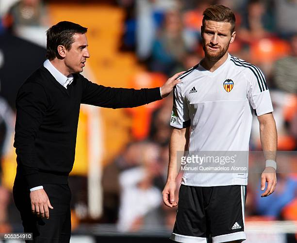 Gary Neville manager of Valencia CF gives instructions to his player Shkodran Mustafi during the La Liga match between Valencia CF and Rayo Vallecano...