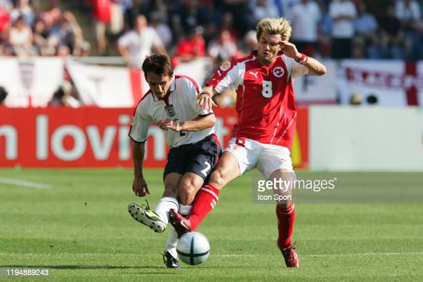 Gary NEVILLE of England and Raphael WICKY of Switzerland during the European Championship match between England and Switzerland at Estadio Cidade de...