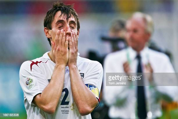 Gary Neville of England shows despair after his team exited the 2006 FIFA World Cup at the quarterfinal stage to Portugal on penalties in...