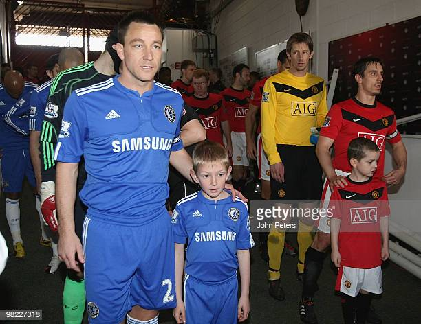 Gary Neville of Manchester United and John Terry of Chelsea prepare to lead their teams out ahead of the FA Barclays Premier League match between...