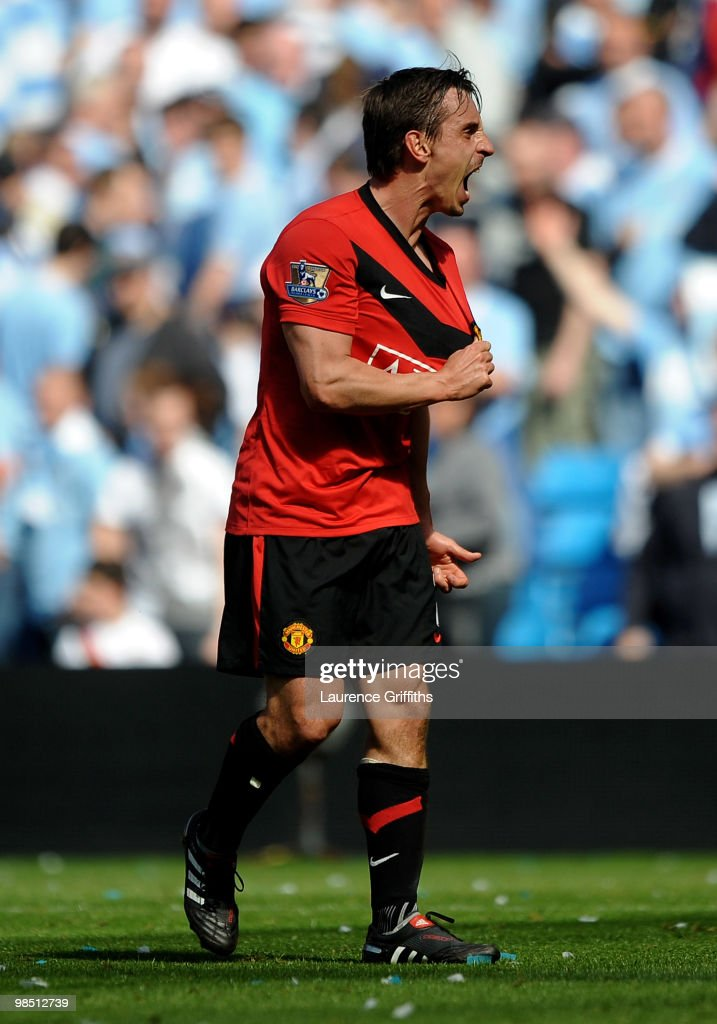 Gary Neville of Manchester United celebrates at the end of the Barclays Premier League match between Manchester City and Manchester United at the City of Manchester Stadium on April 17, 2010 in Manchester, England.