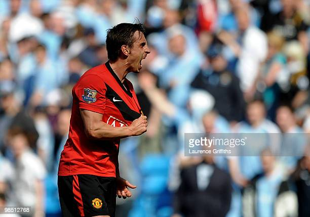 Gary Neville of Manchester United celebrates at the end of the Barclays Premier League match between Manchester City and Manchester United at the...