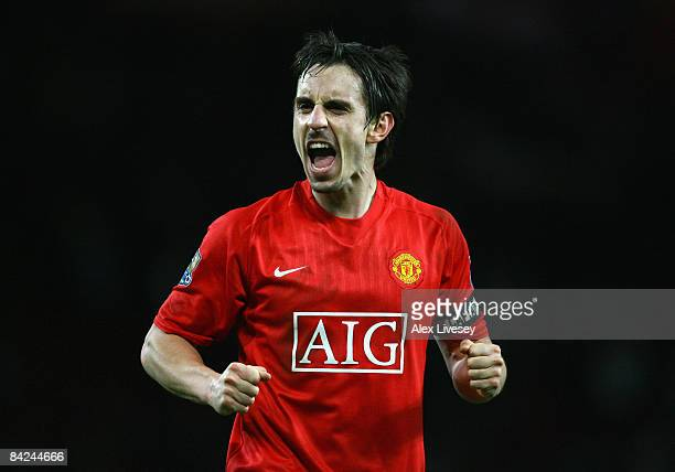 Gary Neville of Manchester United celebrates his team's victory at the end of the Barclays Premier League match between Manchester United and Chelsea...