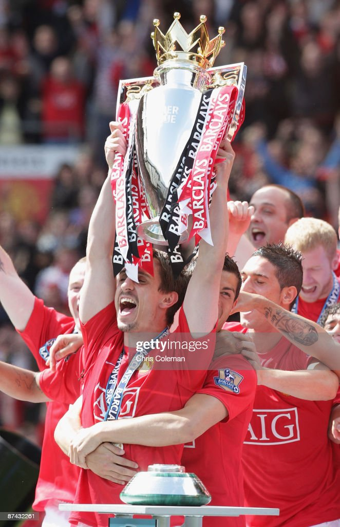 Gary Neville of Manchester United celebrates with the Premier League trophy after the Barclays Premier League match between Manchester United and Arsenal at Old Trafford on May 16 2009 in Manchester, England.