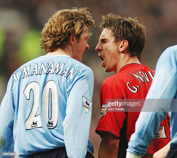 Gary Neville of Manchester United clashes with Steve McManaman of Manchester City during the AXA FA Cup match between Manchester United and...