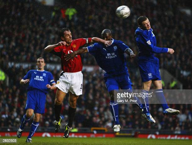 Gary Neville of Manchester United heads the ball into his own net following pressure from Wayne Rooney and Kevin Campbell of Everton during the FA...