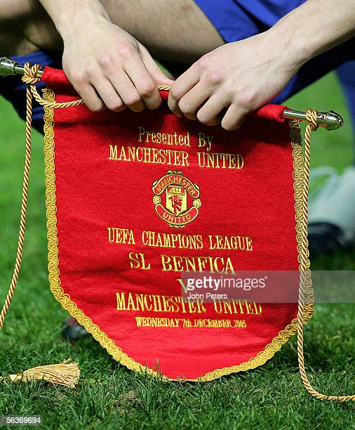 Gary Neville of Manchester United holds the match pennant ahead of the UEFA Champions League match between Benfica and Manchester United at the...