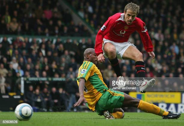 Gary Neville of Manchester United is tackled by Damien Francis of Norwich during the Barclays Premiership match between Norwich City and Manchester...