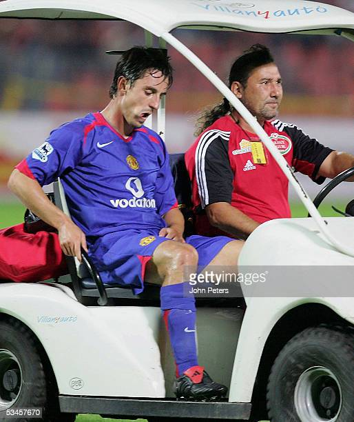 Gary Neville of Manchester United leaves the field with a groin injury during the UEFA Champions League third round qualifying match between...