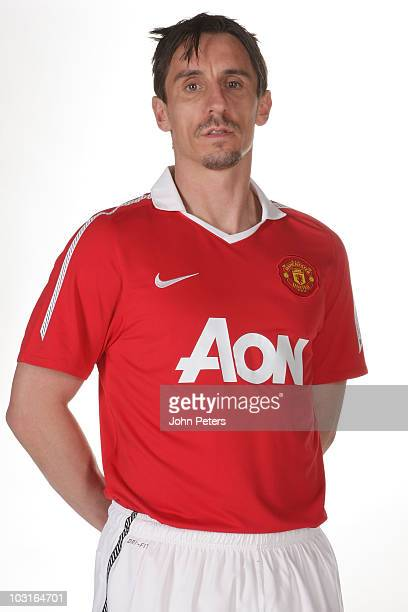 Gary Neville of Manchester United poses in the new Manchester United home kit for the 2010/2011 season on April 14 2010 in Manchester England