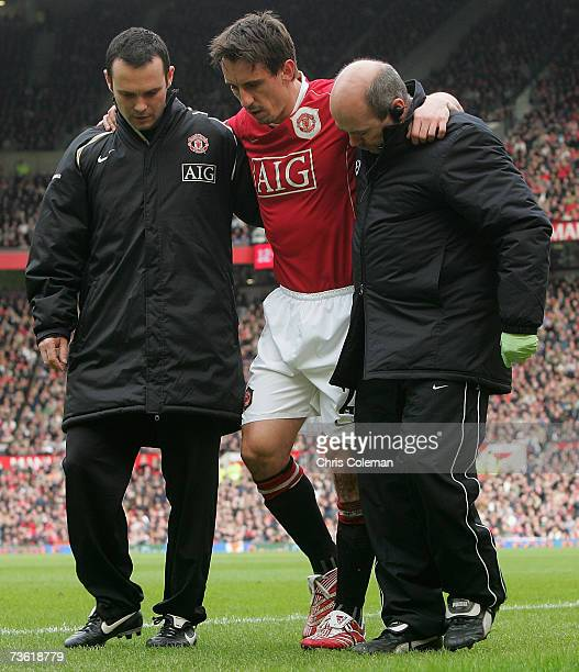 Gary Neville of Manchester United receives treatment for an ankle injury during the Barclays Premiership match between Manchester United and Bolton...
