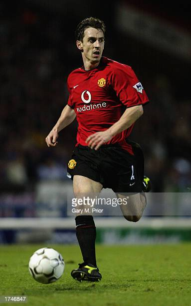 Gary Neville of Manchester United runs with the ball during the Worthington Cup semifinal second leg match between Blackburn Rovers and Manchester...