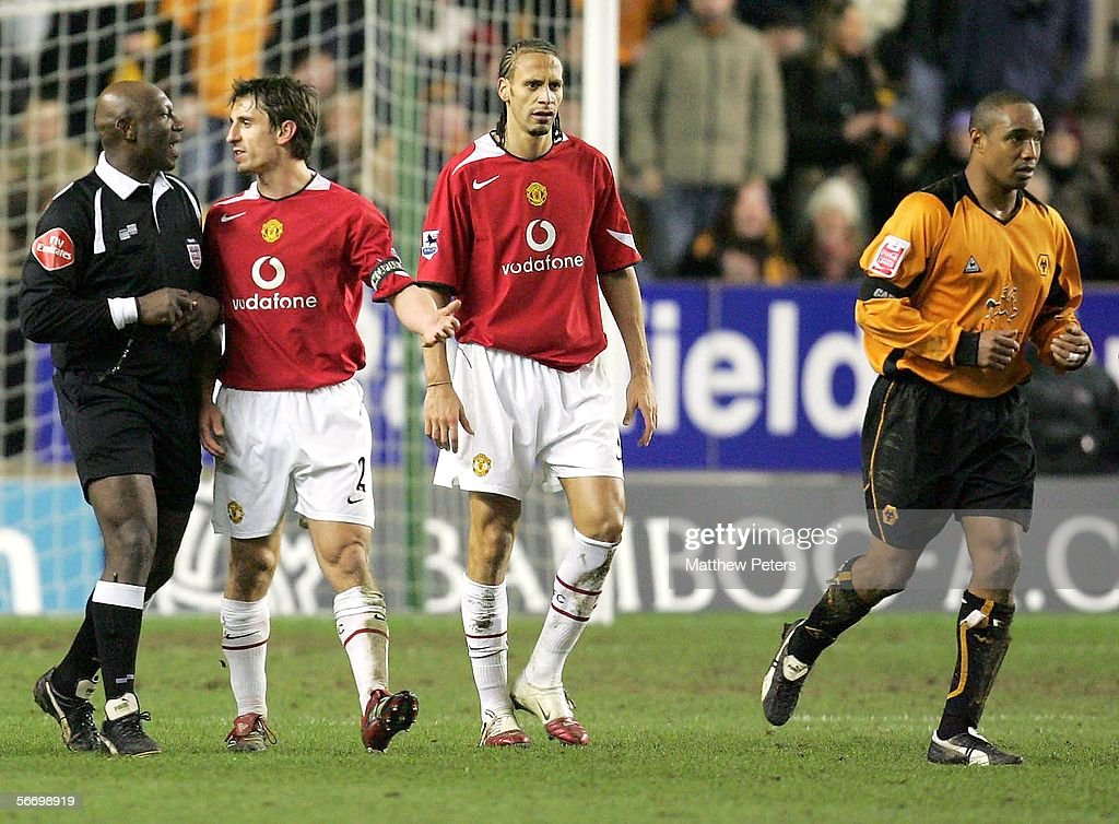 Gary Neville of Manchester United speaks to referee Uriah Rennie after clashing with Paul Ince of Wolverhampton Wanderers during the FA Cup Fourth Round match between Wolverhampton Wanderers and Manchester United at Molineux on January 29 2006 in Wolverhampton, England.