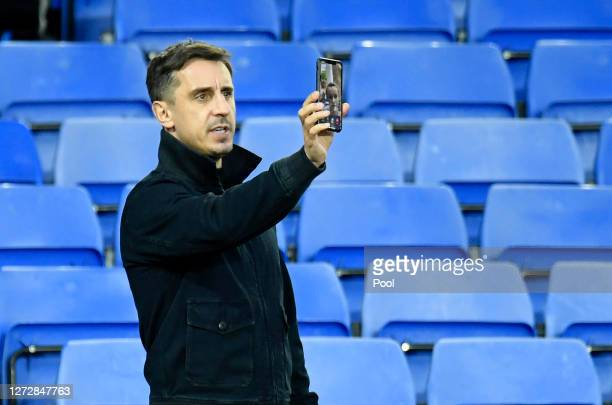 Gary Neville, part owner of Salford City is seen using his phone inside the stadium prior to the Carabao Cup Second Round match between Everton FC...