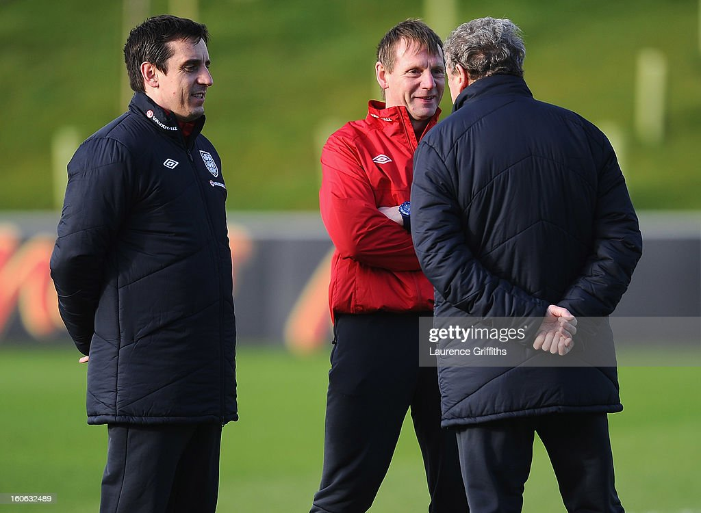 Gary Neville, Stuart Pearce and Roy Hodgson of England share a joke during a training session at St Georges Park on February 4, 2013 in Burton-upon-Trent, England.