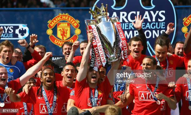 Gary Neville the captain of Manchester United lifts the Barclays Premier League trophy after the Barclays Premier League match between Manchester...