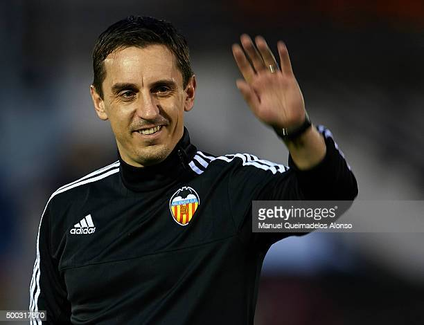 Gary Neville the new manager of Valencia CF greets the fans during a training session ahead of Wednesday's UEFA Champions League Group H match...