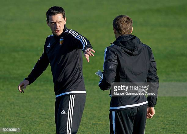 Gary Neville the new manager of Valencia CF talks to Valencia CF assistant Phil Neville during a training session ahead of Wednesday's UEFA Champions...