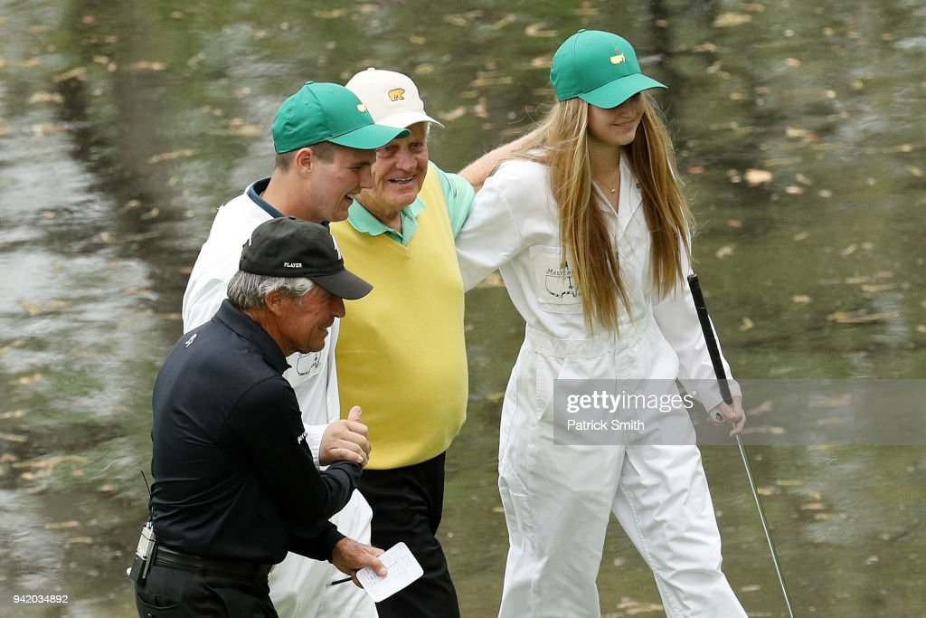 Gary Nicklaus, Jr. (2nd L) celebrates hitting a hole-in-one on the ninth hole with his grandfather Jack Nicklaus (2nd R), Gary Player (L) and his sister (R) during the Par 3 Contest prior to the start of the 2018 Masters Tournament at Augusta National Golf Club on April 4, 2018 in Augusta, Georgia.