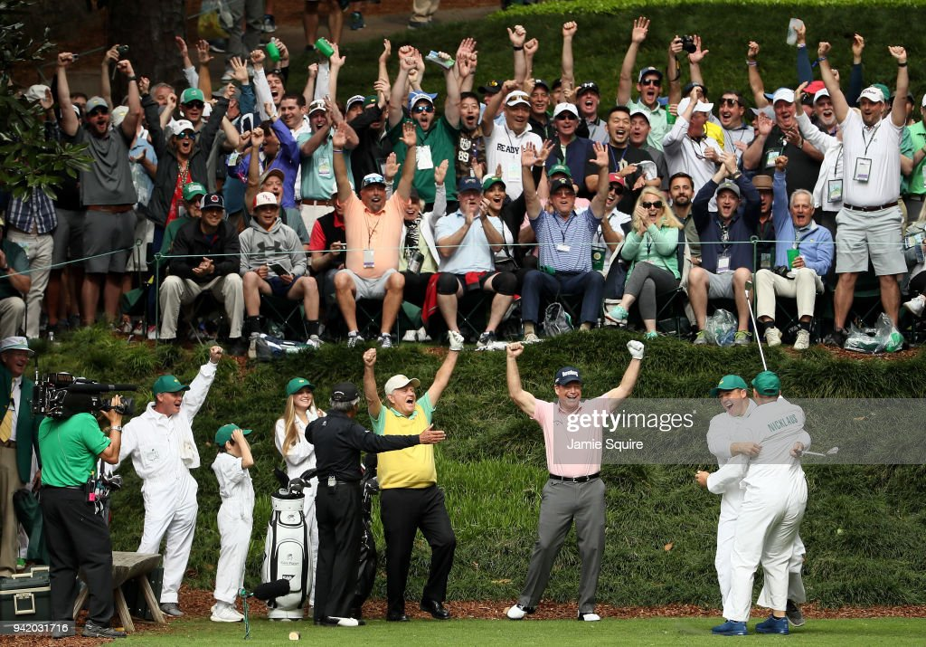 Gary Nicklaus, Jr. celebrates hitting a hole-in-one on the ninth tee with his grandfather Jack Nicklaus, Gary Player and Tom Watson during the Par 3 Contest prior to the start of the 2018 Masters Tournament at Augusta National Golf Club on April 4, 2018 in Augusta, Georgia.