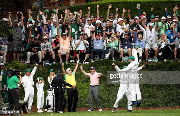 Gary Nicklaus Jr celebrates hitting a holeinone on the ninth tee with his grandfather Jack Nicklaus Gary Player and Tom Watson during the Par 3...