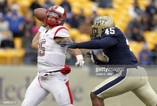 Gary Nova of the Rutgers Scarlet Knights is pressured by Shayne Hale of the Pittsburgh Panthers during the game on November 24 2012 at Heinz Field in...