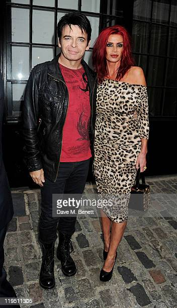 Gary Numan and wife Gemma arrive at the Glenfiddich Mojo Honours List 2011 awards ceremony at The Brewery on July 21 2011 in London England