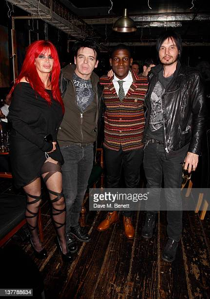Gary Numan and wife Gemma pose with Labrinth and guest as they attend the Raymond Weil PreBrit Awards Dinner hosted by Labrinth at Mosaica The...