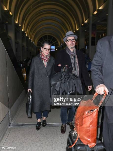 Gary Oldman and Gisele Schmidt are seen at Los Angeles International Airport on January 18 2018 in Los Angeles California