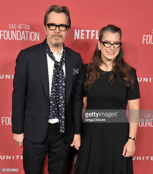 Gary Oldman and Gisele Schmidt arrive at the SAGAFTRA Foundation Patron of the Artists Awards 2017 on November 9 2017 in Beverly Hills California