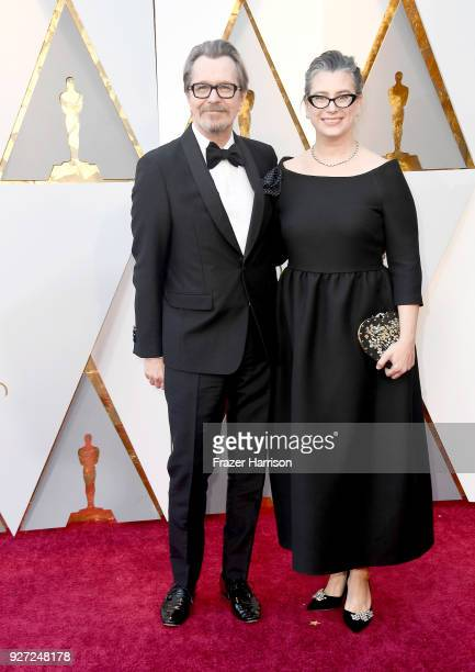 Gary Oldman and Gisele Schmidt attend the 90th Annual Academy Awards at Hollywood Highland Center on March 4 2018 in Hollywood California