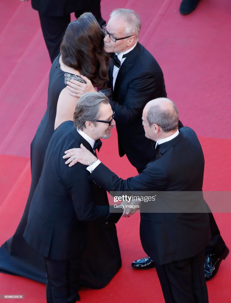 Gary Oldman and Gisele Schmidt greet Cannes Film Festival Director Thierry Fremaux and Cannes Film Festival President Pierre Lescure at the screening of 'Capharnaum' during the 71st annual Cannes Film Festival at Palais des Festivals on May 17, 2018 in Cannes, France.