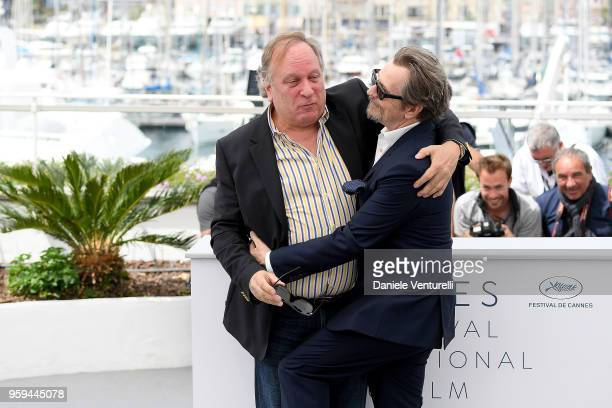 Gary Oldman and guest attend the photocall for RendezVous With Gary Oldman during the 71st annual Cannes Film Festival at Palais des Festivals on May...