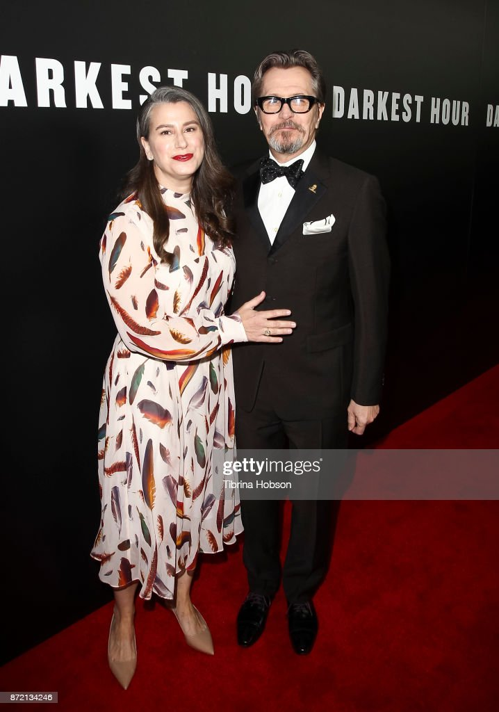 Gary Oldman (R) and his wife Gisele Schmidt (L) attend the premiere of Focus Features 'Darkest Hour' at Samuel Goldwyn Theater on November 8, 2017 in Beverly Hills, California.