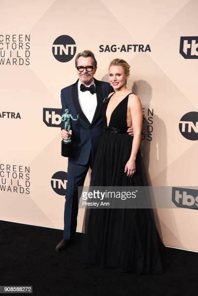 Gary Oldman and Kristen Bell attend 24th Annual Screen Actors Guild Awards - Press Room on January 21, 2018 in Los Angeles, California.