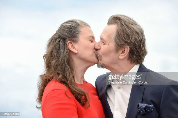 Gary Oldman and wife Gisele Schmidt attend RendezVous With Gary Oldman Photocall during the 71st annual Cannes Film Festival at Palais des Festivals...