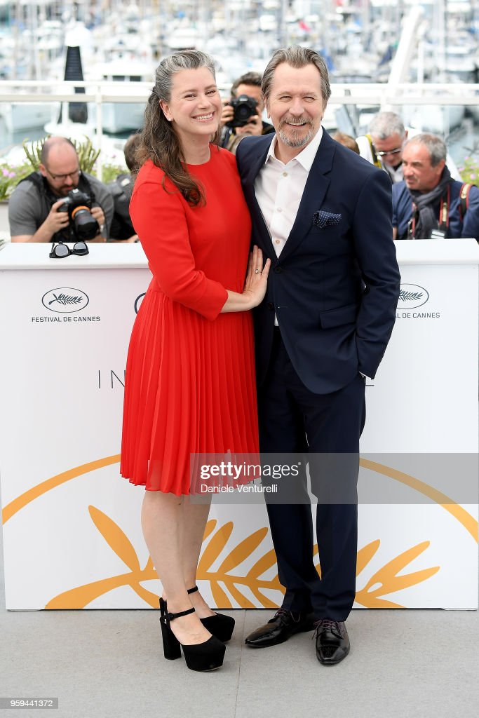 Gary Oldman (R) and wife Gisele Schmidt attends the photocall for Rendez-Vous With Gary Oldman during the 71st annual Cannes Film Festival at Palais des Festivals on May 17, 2018 in Cannes, France.