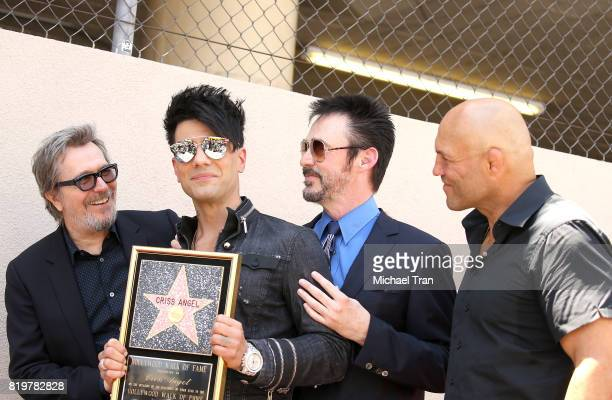 Gary Oldman Criss Angel Lance Burton and Randy Couture attend the ceremony honoring Criss Angel with a Star on The Hollywood Walk of Fame held on...