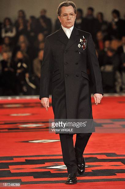 Gary Oldman walks the runway during the Prada ready to Wear Fall/Winter 2012 2013 show as part of the Milan Men Fashion Week on January 15 2012 in...