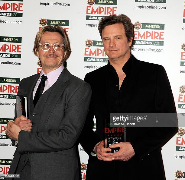 Gary Oldman with the Empire Icon Award with presenter Colin Firth at the Jameson Film Awards at Grosvenor House on March 27 2011 in London England