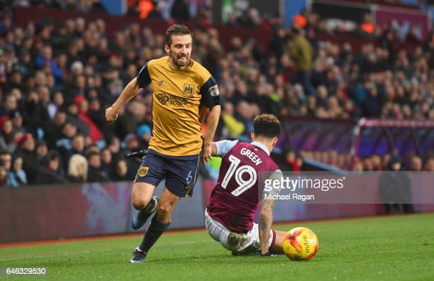 Gary O'Neil of Bristol City evades Andre Green of Aston Villa during the Sky Bet Championship match between Aston Villa and Bristol City at Villa...
