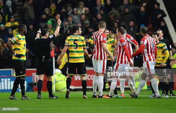 Gary O'Neil of Norwich City is shown a red card by referee Neil Swarbrick during the Barclays Premier League match between Stoke City and Norwich...