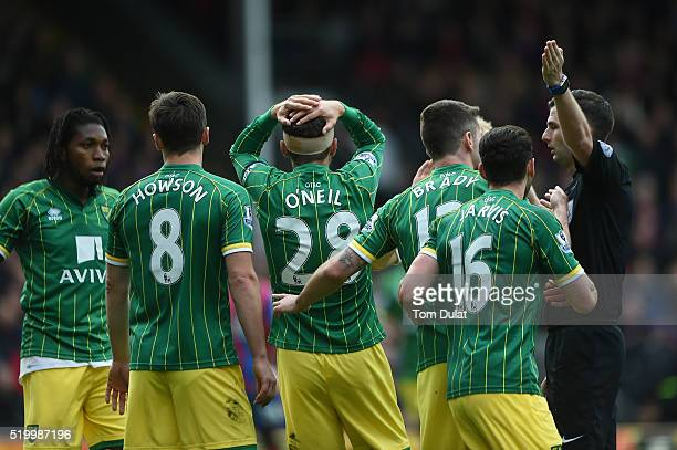 Gary O'Neil of Norwich City reacts with team mates to referee Michael Oliver during the Barclays Premier League match between Crystal Palace and...